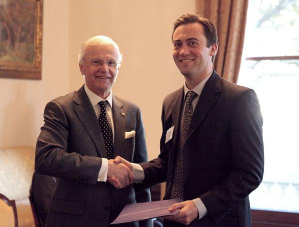 The Governor of Victoria Alex Chernov, awarding Leo Baker the Winston Churchill Fellowship. Photo: Tegan Ringin.